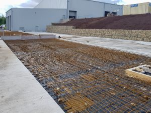 Waste processing facility concrete base